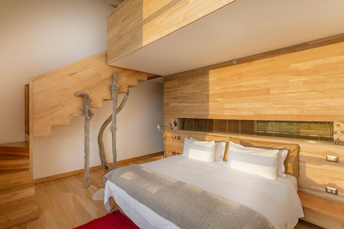 Tierre Patagonia: Viel Holz sorgt für Gemütlichkeit in den Zimmern. Luxusreise